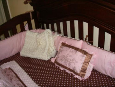 Pink and brown toile baby bedding with a chocolate brown polka dots fitted crib sheet for a baby girl