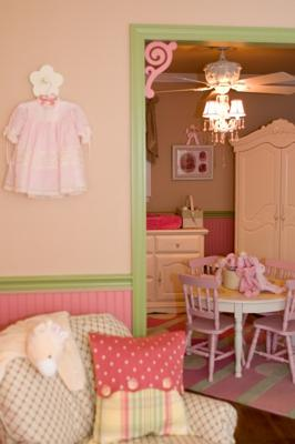 Antique white, mint green and pink country cottage nursery with plaid and polka dots baby bedding and wooden wall letters hung by hot pink and green ribbons on the wall behind the crib.