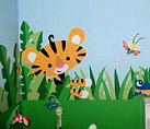 Cute jungle theme baby nursery room with animals monkeys and butterflies