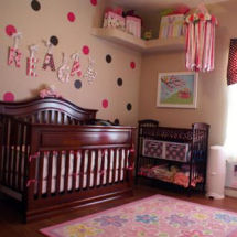 Pink tan and chocolate brown baby girl nursery decorated with polka dots