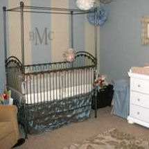 Restful baby boy nursery room with a blue silver and ivory color scheme