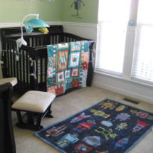 Outer space robots and space rocket ships baby boy nursery theme with crib bedding and area rug