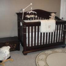 Sweet lamb baby girl nursery with sheep rug crib set and mobile