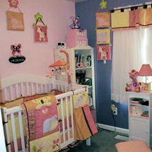 Pink purple yellow and blue tropical jungle nursery theme for a baby girl with zebra crib bedding in pastel colors