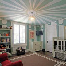 Vintage baby blue and white vintage circus nursery theme with striped painted big top ceiling for a boy