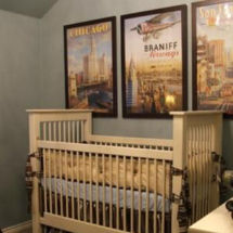 Vintage airplane nursery decor in a baby boy transportation theme room
