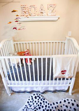 A baby boy nursery decorated in black and white cheetah print