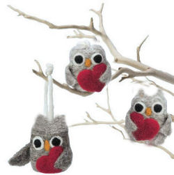 Homemade tree branch mobile with felted owl ornaments