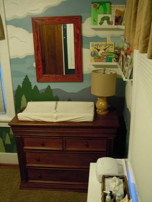 The changing area of the baby's nature themed nursery room