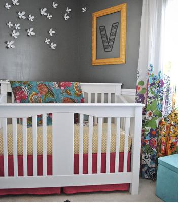 A slightly different baby girl's nursery decorated without lace or pastel pink.