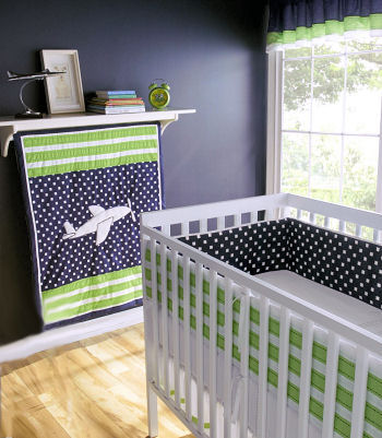 Green black and white airplane baby crib bedding set with polka dots for an aviator nursery theme