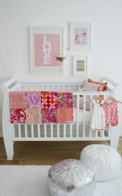 Allegra's modern baby girl nursery decorated in pink white and gray with metallic silver accents