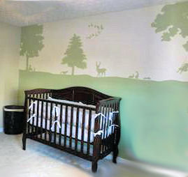 A baby nursery wall mural depicting forest creatures deer and geese flying south for the winter