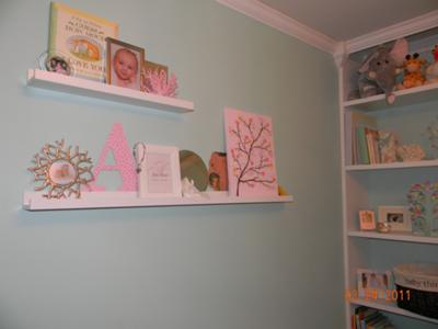 Wall shelves with decorations from previous nurseries and my own room when I was little.  I made the pink letter