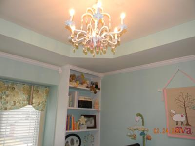 I found the nursery chandelier in an antique store.  It was used in my baby boys' nursery as well as Ava's