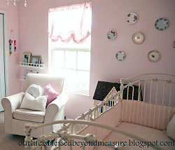 Pink balloon shades for a baby girl nursery window