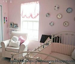 Pink balloon shades for a baby girl nursery window