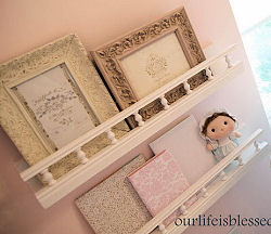 Nursery wall shelves with photos in vintage frames
