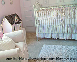 Vintage dollhouse in a pink baby nursery