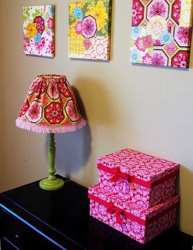 Custom homemade wall art, fabric lamp shade and stacking keepsake boxes for a baby girl's nursery