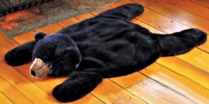 Fake bear skin rug for the rustic log hunting lodge themed nursery room