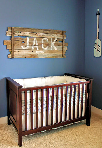 Nautical baby boy nursery with rustic wood sign with Jack's name stenciled in bold letters
