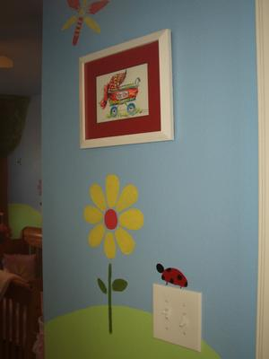 Ladybugs and caterpillars enjoy the flowers and sunshine in our baby girl's nursery.