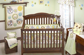 Looney Tunes baby crib bedding and nursery decorations in a Tweety Bird cartoon theme with Bugs Bunny and Sylvester the Cat and Taz with shapes; polka dots and circles