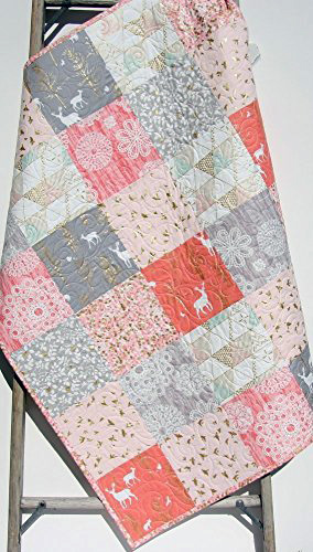 handmade patchwork baby quilt for a girl in a pink and metallic gold woodland forest animal fabric patterns