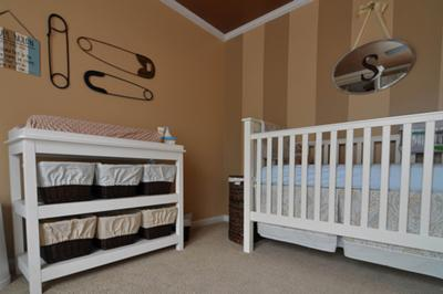 This baby boy nursery is an organized delight with his everyday items stored inside baskets with homemade liners in Pottery Barn style only better.