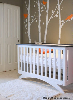 Modern orange brown and white modern baby nursery room with 3d birdhouse tree wall mural