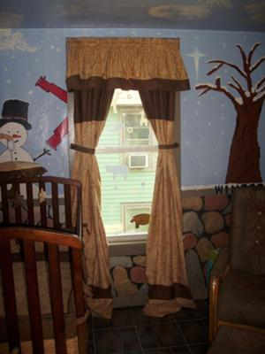 The snowman is just one of the 4 seasons depicted in our nursery wall painting.