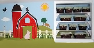 Farm theme nursery wall mural featuring baby farm animals, a big red barn and other farming scenes.
