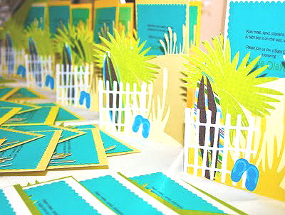Homemade beach theme baby shower invitations with flip flops surf boards in the sand and palm trees