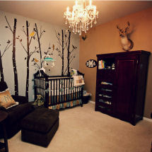 Teal green gold and blue woodland baby boy nursery theme room with deer and forest animals