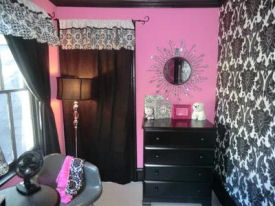 Pink black and white punk baby nursery room design for a girl in a punk theme with damask wallpaper