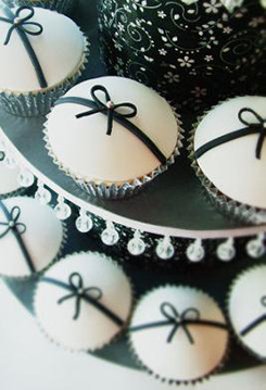 Jeweled decorated black and white baby shower cupcakes