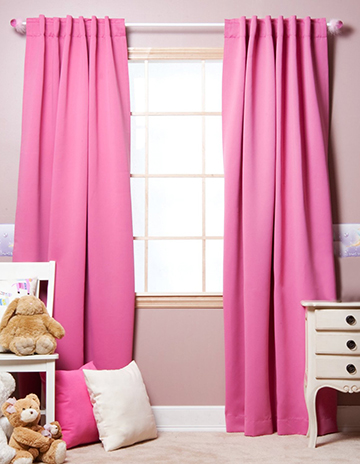 Blackout room darkening curtains window treatments in a baby nursery