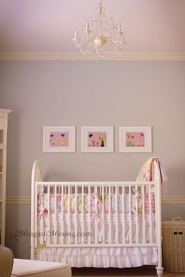 Baby girl nursery with blue gray walls made feminine with a pretty pink ceiling.