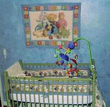 Baby boy's teddy bear nursery theme with blue jean denim blue wall painting technique.