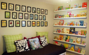 White floating shelves hung from floor to ceiling on a nursery wall