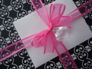 black and white gift wrap box package hot pink ribbon and faux diamond jewel decorations decorated