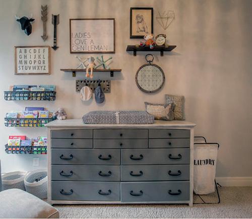 Masculine wall art arrangement in a baby boy nursery room