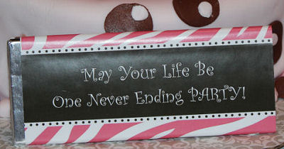 Personalized pink and brown zebra print candy bar wrappers with a saying for a baby girl baby shower.