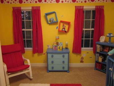The topsy turvy wall plates decorate the wall between the red curtain panels in our baby boy's Dr Seuss theme nursery.