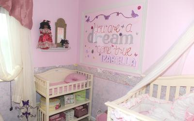 Izabella's beautiful princess nursery room has a wall border hand-painted by her mom.