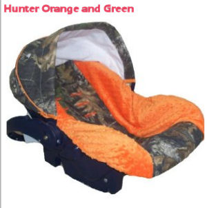 Hunter orange and Realtree Mossy Oak green camouflage baby car seat cover for an infant boy