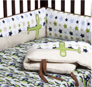 Blue camo baby bedding set in an airplane theme with camo print fabric
