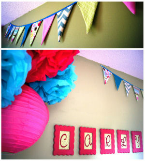 Hot pink and baby blue nursery ceiling mobile made from paper lanterns and tissue paper flowers