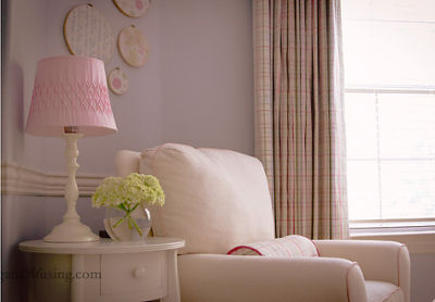 Baby girl Caroline Claire's pink and blue nursery with plaid curtain panels as window treatments